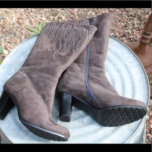 Faux fur lined boots with beaded exterior design